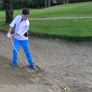 How to Hit a Bunker Shot With an Uphill Lie